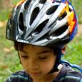 Boy in a properly fitting bike helmet