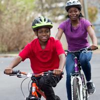 Mother and son take a ride on their bikes.