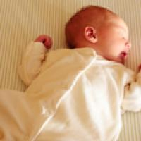 Baby placed in a safe sleep position