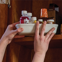 Medication being stored up and away in a top cabinet.
