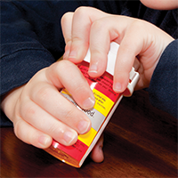 A child tries to open a medication bottle.