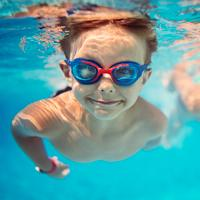 A takes a swim under water while wearing his goggles.
