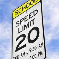 A school speed limit traffic sign.