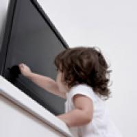 Child tipping over an unsecured TV