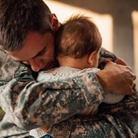 A father hugs his child.