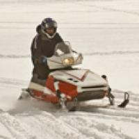Rider wearing proper snow mobile safety gear