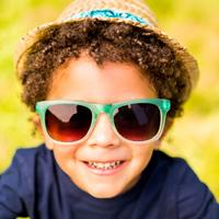 Kid in glasses and hat ready to enjoy summer