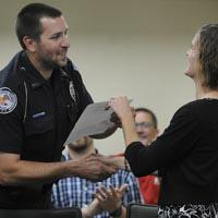 Dustin Gessert receives a Badge of Courage Award