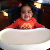 Baby in high chair ready for the holidays