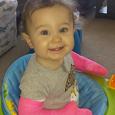 Little Hattie shows off her pink casts.