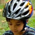 Boy in a properly fitting bike helmet