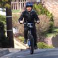 A kid bikes to school.