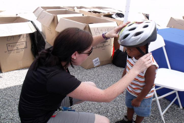 Getting fitted for a bike helmet.