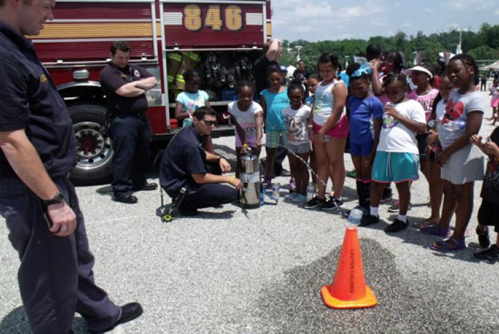 The Prince George's Fire Department teaching kids to use a fire extingusher.