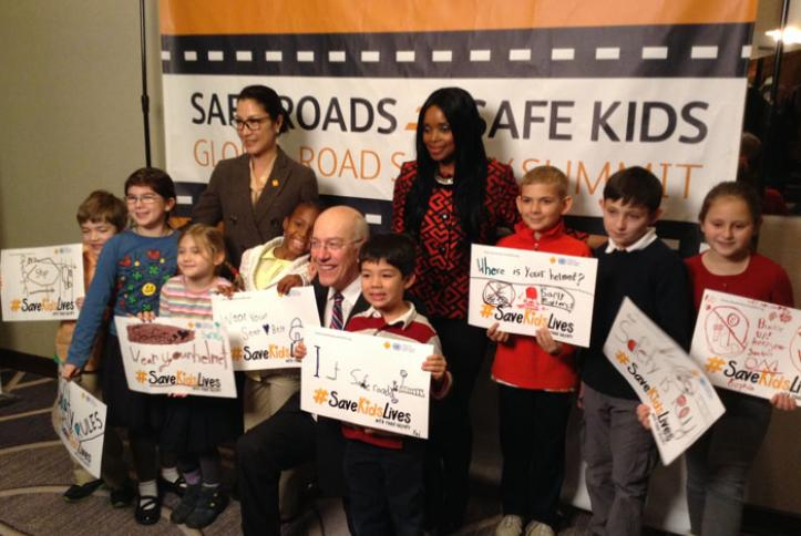 Zoleka Mandela, Michelle Yeoh and Dr. Kurt Newman take a #safie with kids.