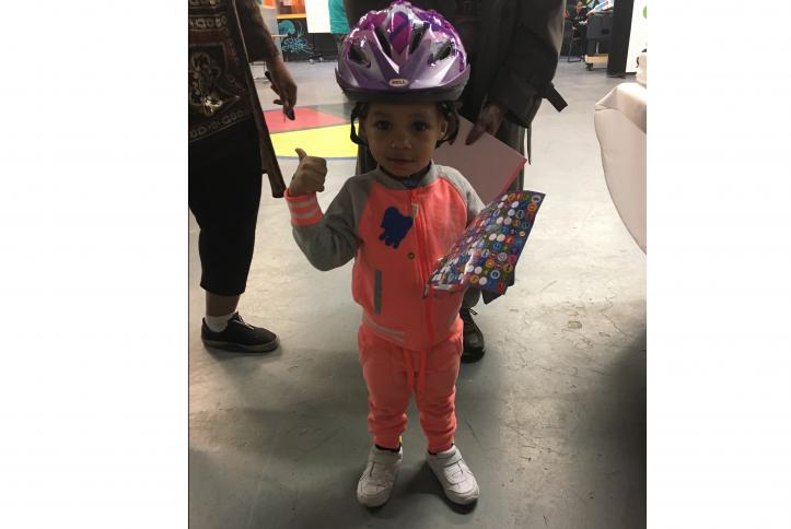 Cute little kid with his bike helmet at the GM Detroit Checkup Event