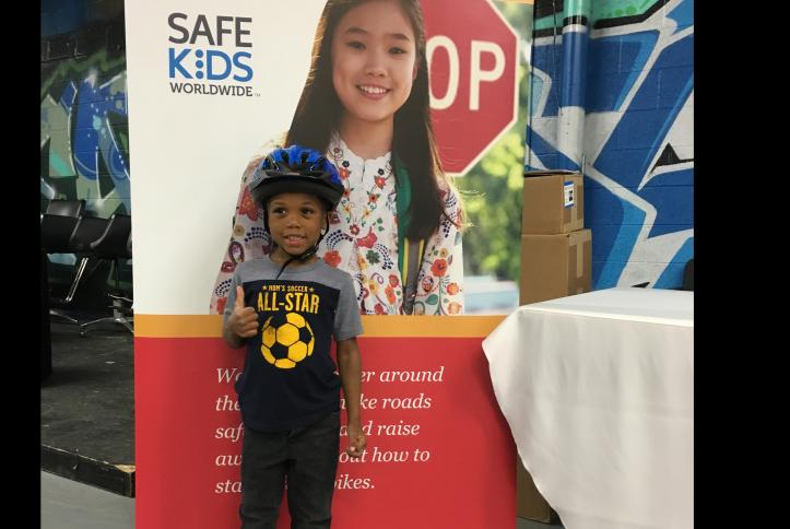Little Boy give thumbs up at the GM Detroit Checkup Event