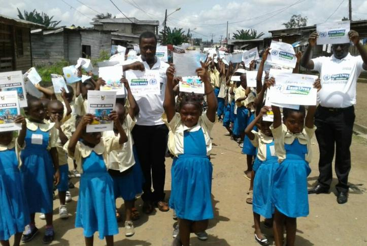 Kids in Cameroon showing their pledges for Global Road Safety Week