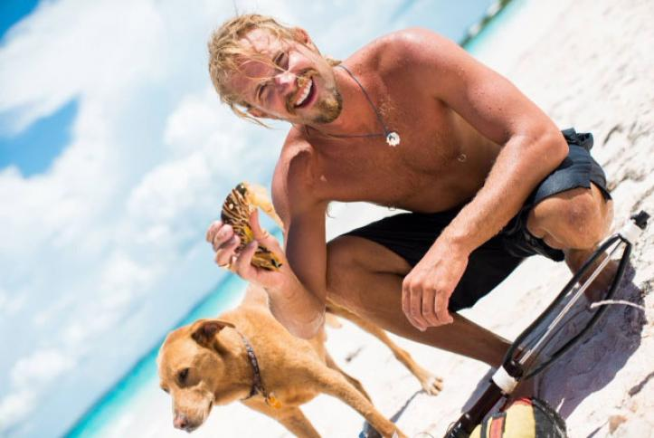 Ben Haller out on the beach with his loving dog.