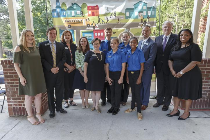 The staff and administration of Atlanta Public Schools for the afe School Zone ribbon cutting at Inman Middle School