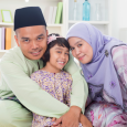 Malaysian family in home