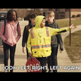 kids being directed by a crossing guard before they cross the street