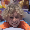 Boy playing in ball pit at Safe Kids Day