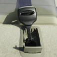 A tether lock on the top rearseat shelf of a car